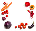 Red vegetables isolated on white top view. Vegetable frame or background Royalty Free Stock Photo