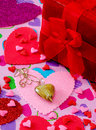Red velvet box with hearts and necklace heart on a chain is surrounded by colorful a for valentines day Royalty Free Stock Photos
