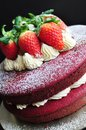 Red velvet cake decorated with fresh strawberries Royalty Free Stock Photo