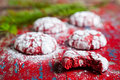 Red velvet crinkle cookies cooling on a vintage wooden table for christmas holiday baking Royalty Free Stock Images