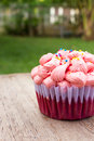 Red velvet cupcake on wood background. Royalty Free Stock Photo