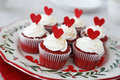 Red velvet cupcakes decorated for christmas with hearts Stock Photo