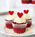 Red velvet cupcakes redvelvet with cream cheese frosting and a heart Stock Image
