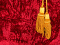 Red velvet with yellow tassels Royalty Free Stock Image
