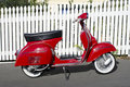 Red Vespa motor scooter Royalty Free Stock Images