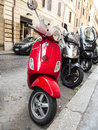 Red vespa scooter on a cobblestone street in rome italy Royalty Free Stock Photos