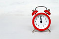 Red vintage alarm clock striking midnight (or midday) Royalty Free Stock Photo