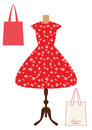 Red vintage beautiful dress with white leaves and two bags, vector flat illustration. Isolated on white. Woman dresses on a manneq
