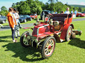 Red vintage car in Marlay Park. Royalty Free Stock Photo