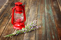 Red vintage kerosene lamp and lavender flowers on wooden table fine art concept aromatic Stock Images