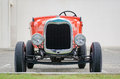 Red vintage old timer car parked Royalty Free Stock Photo