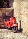 Red vintage scooter Royalty Free Stock Photo