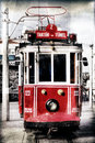 Red vintage tram in istanbul with filter applied at the taksim square vinatge style turkey filters Stock Photo