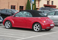 Red Volkswagen New Beetle cabrio Royalty Free Stock Photo