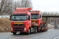 Red Volvo FH Exceptional Transport of Identical Truck Royalty Free Stock Photo