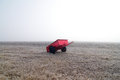 Red wagon and field in fog Royalty Free Stock Photo