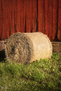 Red wall and a bale of hay Royalty Free Stock Image