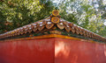 Red wall with golden tile in the forbidden city beijing china Royalty Free Stock Images