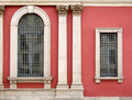 Red wall and ornate windows Stock Photo