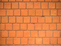 Red wall, square bricks. Royalty Free Stock Photo