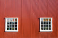 Red wall and two windows seen in reykjavik icleand Stock Images