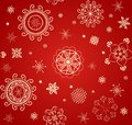 Red wallaper for winter holiday with lacy golden baubles Royalty Free Stock Photo