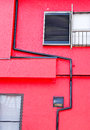 Red walls of the house looking from the side Stock Photography