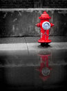 Red water hydrant detail of with puddle of Stock Image