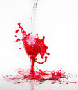 Red water spill from a broken wine glass on a white background Royalty Free Stock Photo