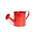 Red watering can on the white background the watering can made ​​of metal Stock Images
