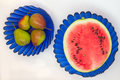 Red watermelon and pears in blue glass vases Royalty Free Stock Photo