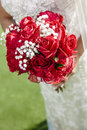 Red wedding bouquet bride holding a Stock Image