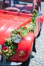 Red wedding car detail view of a with flower bouquet Stock Image