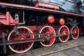 Red wheel on a steam train locomotive Royalty Free Stock Photo