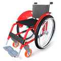 Red wheelchair on white background standing Royalty Free Stock Photo