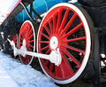 Red wheels of old locomotive Stock Image