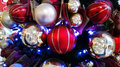 Red white blue christmas ornaments shiney baubles or balls in a group in and Stock Photography