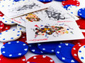Red White and Blue Poker Chips and Jokers on White Stock Photo