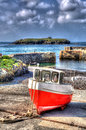 Red and white boat Mullion Cove harbour Cornwall UK in colourful bright HDR Royalty Free Stock Photo