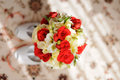 Red and white bouquet wedding on carpet in sunlight Royalty Free Stock Photos