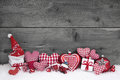 Red white checked christmas decoration on grey wooden background Royalty Free Stock Photo