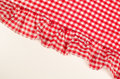 Red and white checkered cloth a with flounce copy space available Stock Photos