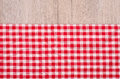 Red and white checkered cloth on wood as background Royalty Free Stock Photos