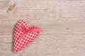 Red and white checkered heart with ribbon of bow on wood Stock Image