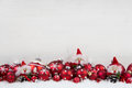 Red and white christmas background of wood with balls and goblin Royalty Free Stock Photo