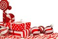 Red and white Christmas corner border with gifts, baubles, candy Royalty Free Stock Photo