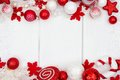 Red and white Christmas ornament double border over white wood Royalty Free Stock Photo