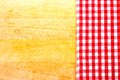 Red and white cloth grille on a chopping board Royalty Free Stock Photo