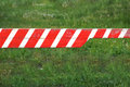 Red and white colored street barrier at an empty road Closed Royalty Free Stock Photo