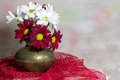 Red and white daisies in a copper vase chrysantemum miniature Stock Photography